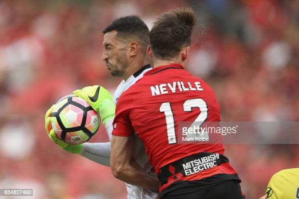 Paul Izzo of the Mariners secures the ball as he collides with Scott Neville of the Wanderers during the round 19 ALeague match between the Western...