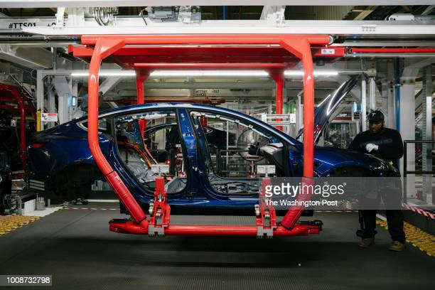 Paul Jacob works on the general assembly of the Tesla Model 3 at the Tesla factory in Fremont California on Thursday July 26 2018