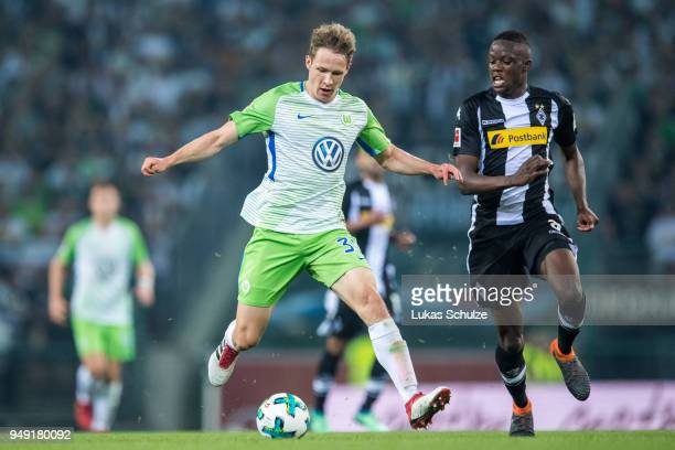 Paul Jaeckel of Wolfsburg and Denis Zakaria of Moenchengladbach in action during the Bundesliga match between Borussia Moenchengladbach and VfL...