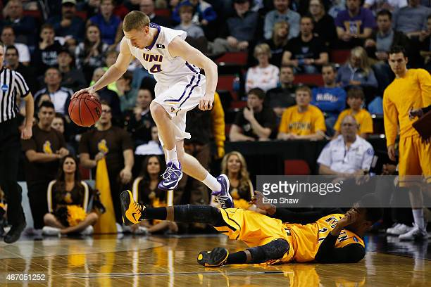 Paul Jesperson of the Northern Iowa Panthers carries the ball over Derek Cooke Jr #11 of the Wyoming Cowboys during the second round of the 2015...