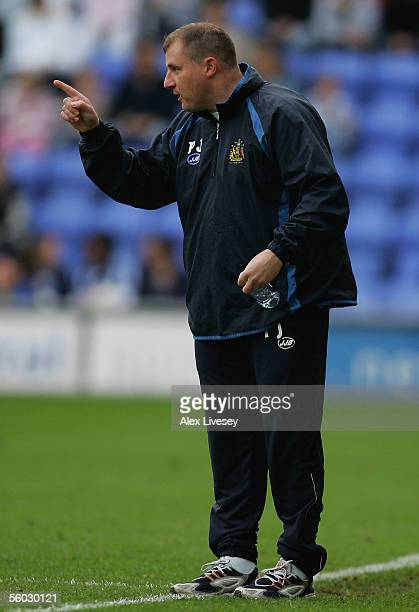 Paul Jewell manager of Wigan Athletic gives instructions to his players during the Barclays Premiership match between Wigan Athletic and Fulham at...