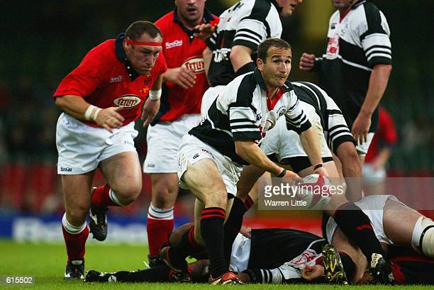 Paul John of Pontypridd passes the ball as Robin McBryde of Llanelli closes in during the Principality Cup Final played at the Millennium Stadium, in...