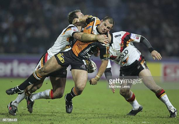 Paul Johnson of Bradford tackles Ben Galea of Wests Tigers during the Carnegie World Club Challenge match between Bradford Bulls and Wests Tigers at...