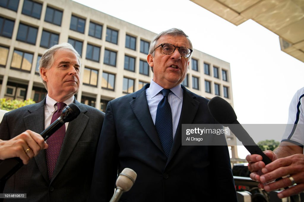 Paul Kamenar, attorney for Roger Stone associate Andrew Miller, speaks to reporters beside Peter Flaherty, Chairman of the National Legal and Policy Center, left, after Miller refused to testify before a grand jury hearing as part of special counsel Robert Mueller's investigation into Russian interference in the 2016 presidential election, outside of U.S. District Court, on August 10, 2018 in Washington.