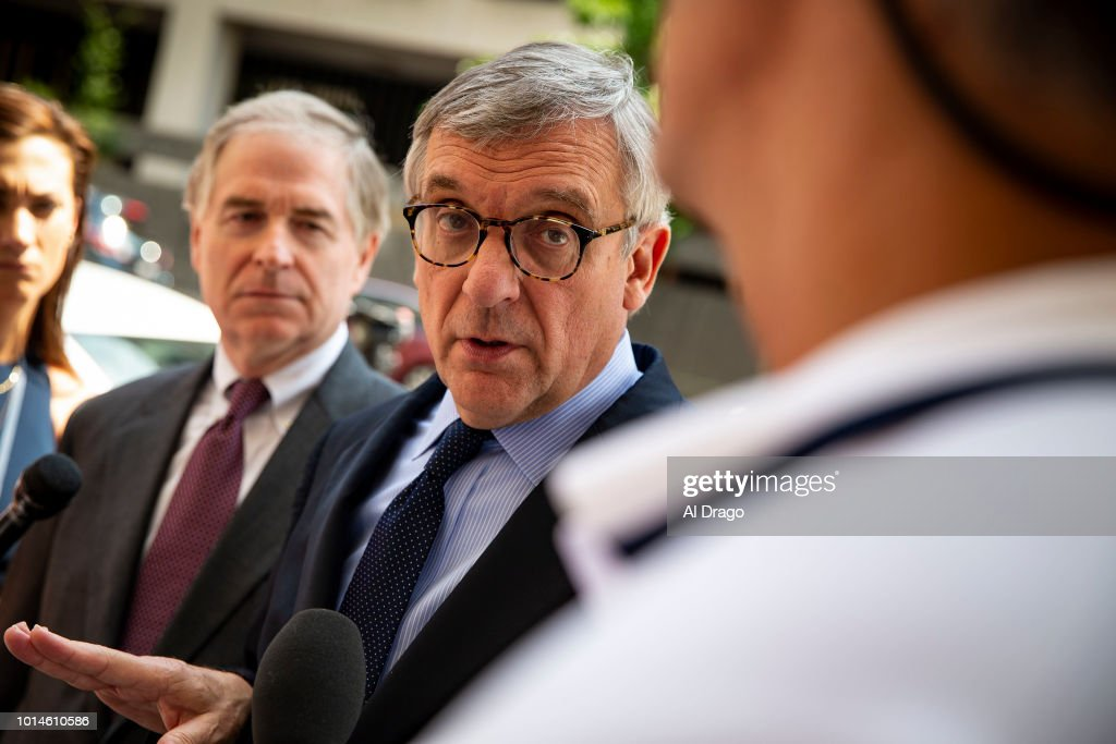 Paul Kamenar, attorney for Roger Stone associate Andrew Miller, speaks to reporters beside Peter Flaherty, Chairman of the National Legal and Policy Center, left, after Miller refused to testify before a grand jury hearing as part of special counsel Robert Mueller's investigation into Russian interference in the 2016 presidential election, outside of U.S. District Court, on August 1, 2018 in Washington.