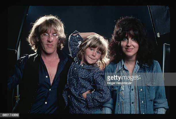 Paul Kantner and Grace Slick of the band Jefferson Starship with their daughter China during the recording of their Earth album.