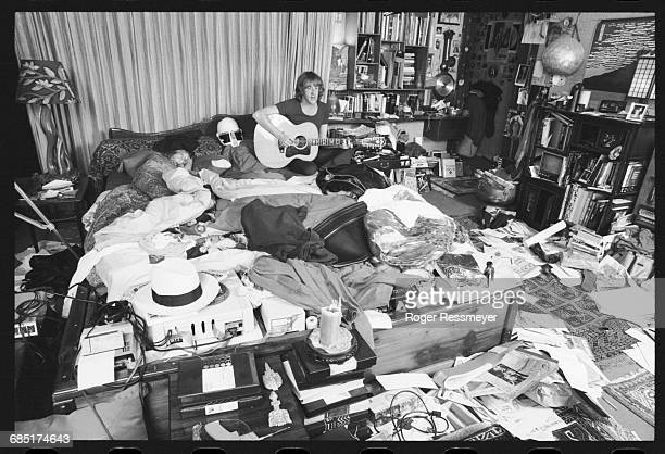 Paul Kantner sits up in bed and plays an acoustic guitar, his daughter China beside him, in a rather messy bedroom.