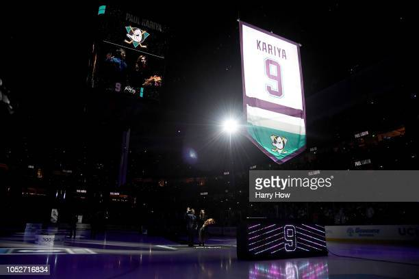 Paul Kariya of the Anaheim Ducks and girlfriend Valerie Dawson watch during his jersey retirement ceremony at Honda Center on October 21 2018 in...