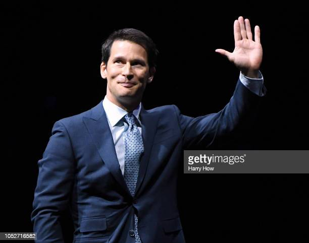 Paul Kariya of the Anaheim Ducks waves to fans during his jersey retirement ceremony at Honda Center on October 21 2018 in Anaheim California