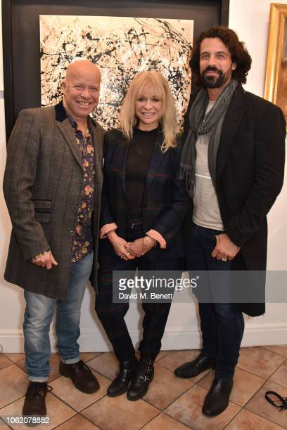 Paul Karslake Jo Wood and Christian Vit attend a private view of artist Paul Karslake's exhibition at The Marylebone Gallery on November 15 2018 in...