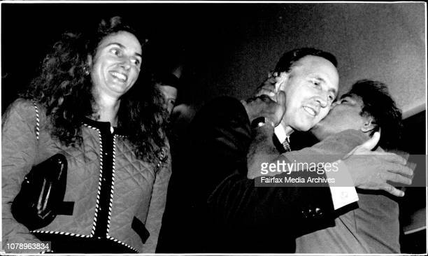 PM Paul Keating hugged and kissed by a supporter as the Prime Minister leaves the Bankstown Sports Club after his victory watched by Annita Keating...