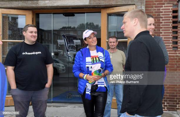 Paul Keuter of Hertha BSC with members of the supporter club HerthaJunxx in front of the office of Hertha BSC on july 12 2018 in Berlin Germany
