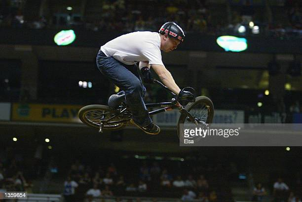 Paul Kintner of Salem Oregon competes in the bike stunt event during the ESPN Extreme X Games VIII on August 16 2002 at the First Union Complex in...