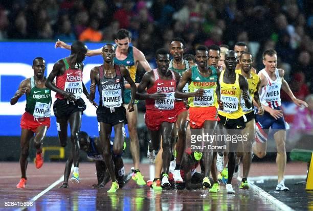 Paul Kipkemoi Chelimo of the United States falls as Cyrus Rutto of Kenya Mohammed Ahmed of Canada Birhanu Balew of Bahrain and Selemon Barega of...