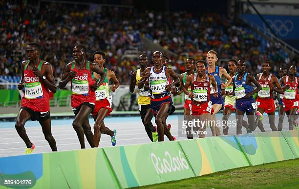 Paul Kipngetich Tanui and Geoffrey Kipsang Kamworor of Kenya compete in the Men's 10000m on Day 8 of the Rio 2016 Olympic Games at the Olympic...