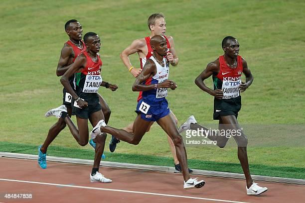 Paul Kipngetich Tanui of Kenya Mohamed Farah of Great Britain and Geoffrey Kipsang Kamworor of Kenya compete in the Men's 10000 metres final during...