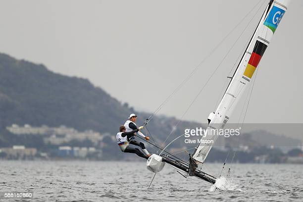 Paul Kohlhoff of Germany and Carolina Werner of Germany compete in the Nacra 17 Mixed class on Day 5 of the Rio 2016 Olympic Games at the Marina da...