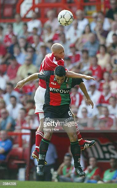 Paul Konchesky of Charlton gets tangled with Resit Schuurman of NECNijmegen during the preseason friendly match between Charlton Athletic and...
