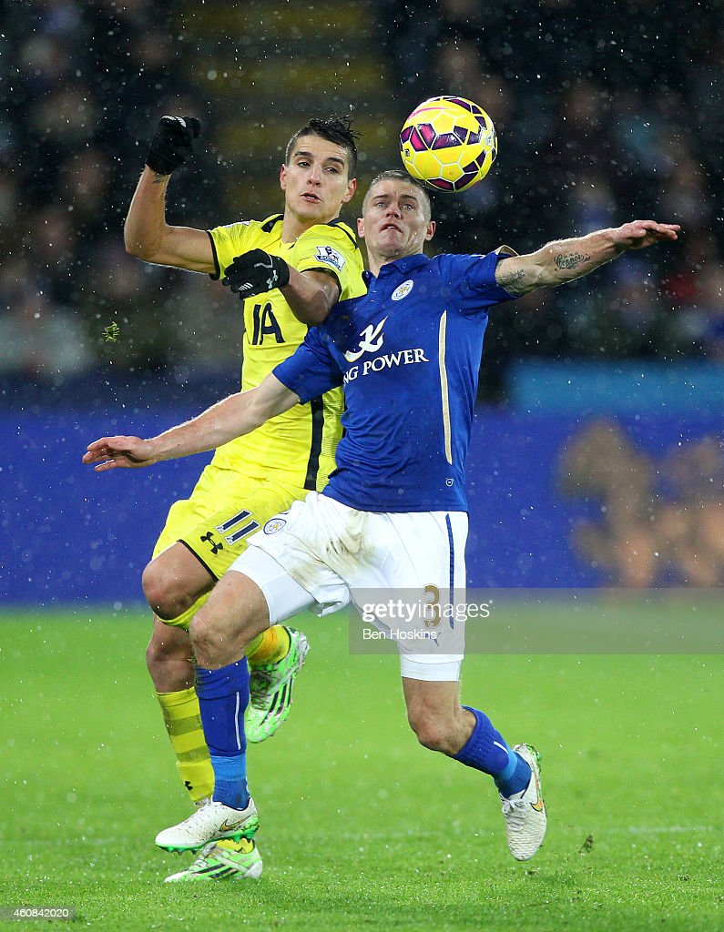 Paul Konchesky of Leicester City battles for the ball with Erik Lamela of Spurs during the Barclays Premier League match between Leicester City and Tottenham Hotspur at The King Power Stadium on December 26, 2014 in Leicester, England.