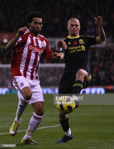 Paul Konchesky of Liverpool in action with Jermaine Pennant of Stoke City during the Barclays Premier League match between Stoke City and Liverpool...