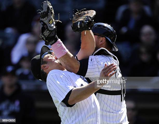 Paul Konerko hangs on to the ball to record the out after colliding with A.J. Pierzynski of the Chicago White Sox on a pop up by Alex Gonzalez the...