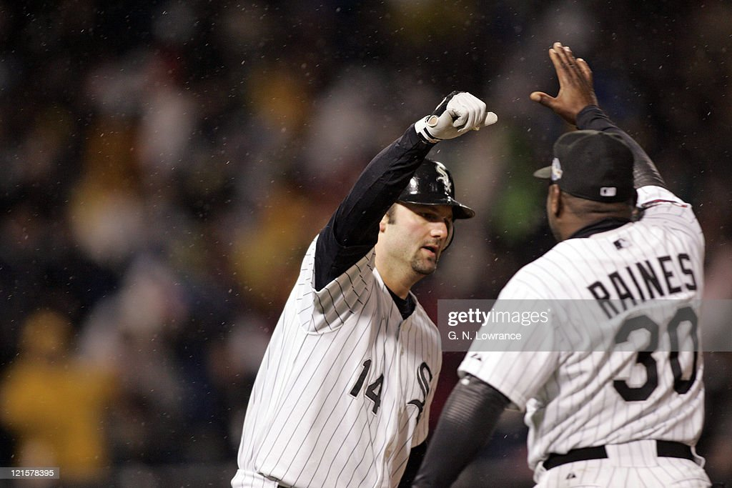 Paul Konerko of the Chicago White Sox celebrates hitting a grand slam in the 7th inning during game 2 of the World Series against the Houston Astros at US Cellular Field in Chicago, Illinois on October 23, 2005. The White Sox won 7-6.