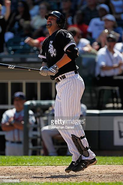 Paul Konerko of the Chicago White Sox follows the flight of his game winning home run a tworun shot in the 8th inning against the Atlanta Braves at...