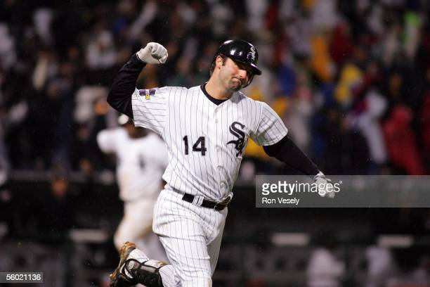 Paul Konerko of the Chicago White Sox reacts after hitting a grand slam home run in the bottom of the seventh inning during Game 2 of the 2005 World...
