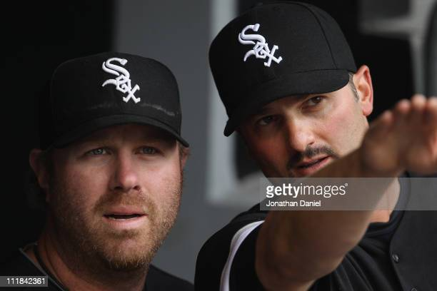 Paul Konerko of the Chicago White Sox talks about the stadium to teammate Adam Dunn before the home opener against the Tampa Bay Rays at US Cellular...