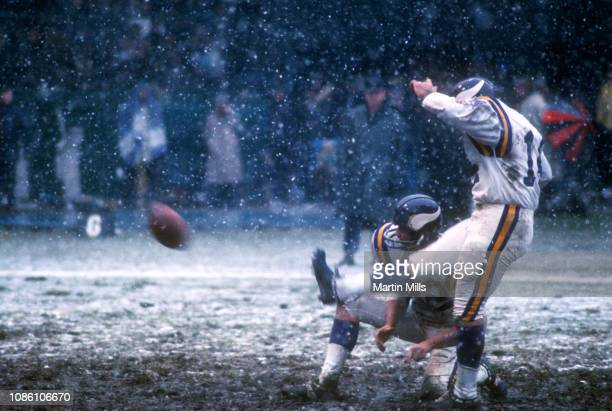 Paul Krause of the Minnesota Vikings holds the ball for kicker Fred Cox during an NFL game against the Detroit Lions on November 27 1969 at Tiger...