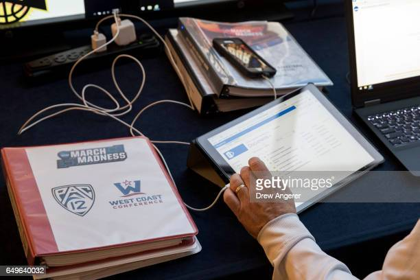 Paul Krebs vice president and director of athletics at the University of New Mexico looks at notes as the NCAA Basketball Tournament Selection...