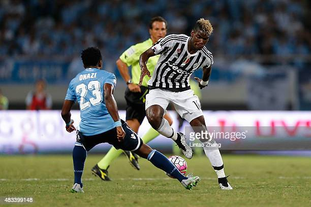 Paul Labile Pogba of Juventus FC contests the ball against Eddy Onazi of Lazio during the Italian Super Cup final football match between Juventus and...