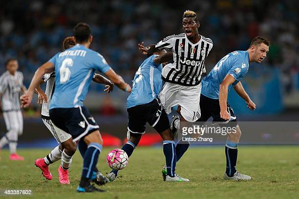 Paul Labile Pogba of Juventus FC contests the ball against Stefan De Vrij and Eddy Onazi of Lazio during the Italian Super Cup final football match...