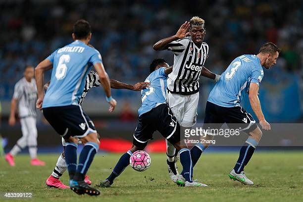 Paul Labile Pogba with Kingsley Coman of Juventus FC challenges Stefan De Vrij and Eddy Onazi of Lazio during the Italian Super Cup final football...