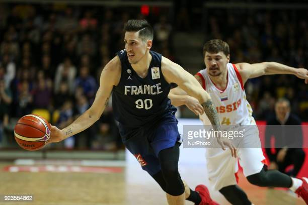 Paul Lacombe of France fights for the ball with Evgenii Baburin 4 of Russia during FIBA Basketball World Cup 2019 qualifier match between France and...
