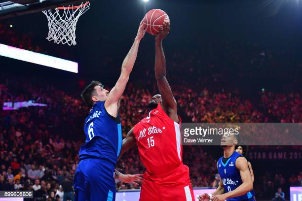 Paul Lacombe of French All Stars blocks Zachery Peacock of International All Stars during the All Star Game at AccorHotels Arena on December 29 2017...