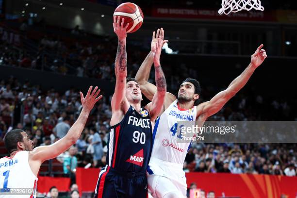 Paul Lacombe of the France National Team in action against Juan Garcia and Dagoberto Pena of the Dominican Republic National Team during the 1st...