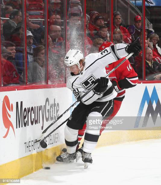Paul LaDue of the Los Angeles Kings battles along the boards for a loose puck during an NHL game against the Carolina Hurricanes on February 13 2018...