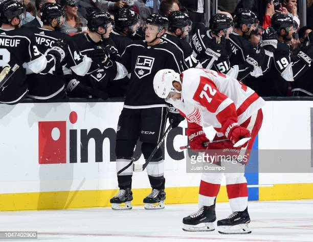 Paul LaDue of the Los Angeles Kings celebrates his secondperiod goal with the bench as Andreas Athanasiou of the Detroit Red Wings reacts during the...