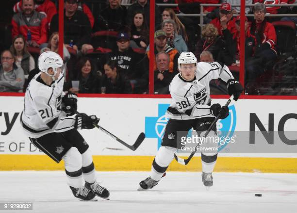Paul LaDue of the Los Angeles Kings skates with the puck along side teammate Nick Shore during an NHL game on February 13 2018 at PNC Arena in...