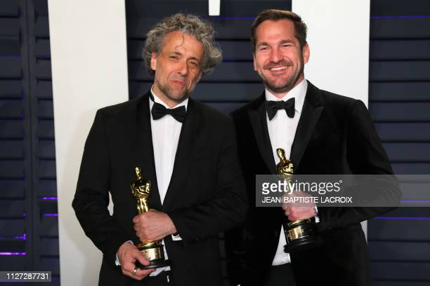 Paul Lambert and JD Schwalm winners of the Academy Award for Best Visual Effects for First Man pose with their Oscars as they attend the 2019 Vanity...