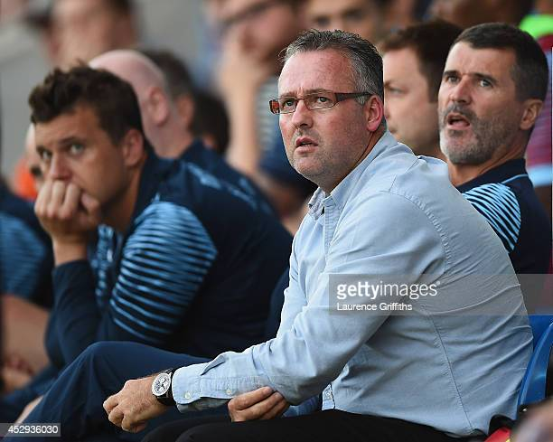 Paul Lambert and Roy Keane of Aston Villa look on during the Pre Season Friendly between Cheterfield and Aston Villa at Proact Stadium on July 30...