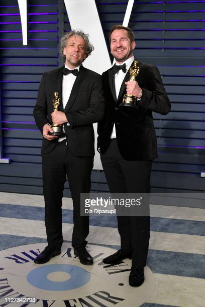 Paul Lambert and Tristan Myles winners of Best Visual Effects attend the 2019 Vanity Fair Oscar Party hosted by Radhika Jones at Wallis Annenberg...