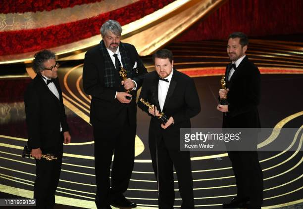 Paul Lambert Ian Hunter J D Schwalm and Tristan Myles accept the Best Visual Effects award for First Man onstage during the 91st Annual Academy...