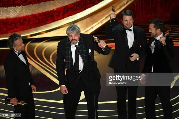 Paul Lambert Ian Hunter Tristan Myles and J D Schwalm accept the Visual Effects award for 'First Man' onstage during the 91st Annual Academy Awards...