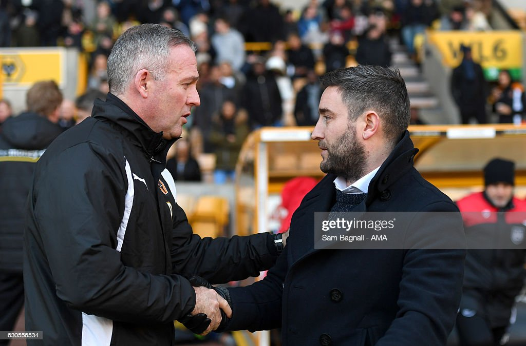 Paul Lambert manager / head coach of Wolverhampton Wanderers shakes hands with Lee Johnson manager / head coach of Bristol City during the Sky Bet Championship match between Wolverhampton Wanderers and Bristol City at Molineux on December 26, 2016 in Wolverhampton, England.