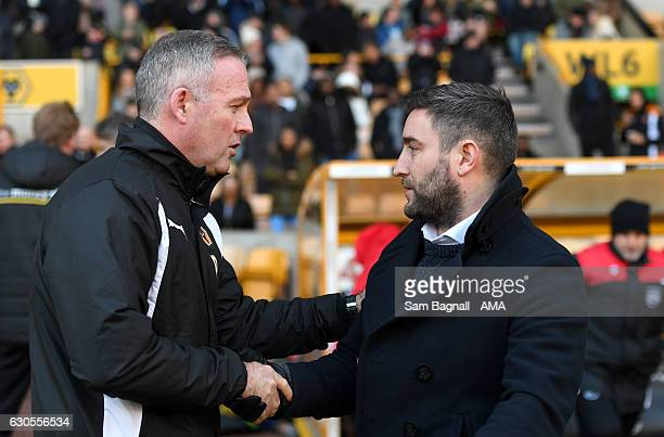 Paul Lambert manager / head coach of Wolverhampton Wanderers shakes hands with Lee Johnson manager / head coach of Bristol City during the Sky Bet...