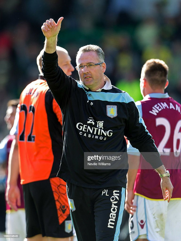 Paul Lambert manager of Aston Villa celebrates his team's victory after the Barclays Premier League match between Norwich City and Aston Villa at Carrow Road on May 04, 2013 in Norwich, England.