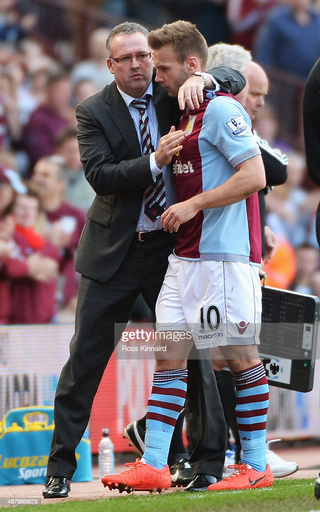 Paul Lambert, manager of Aston Villa congratulates goalscorer Andreas Weimann as he is substituted during the Barclays Premier League match between Aston Villa and Hull City at Villa Park on May 3, 2014 in Birmingham, England.