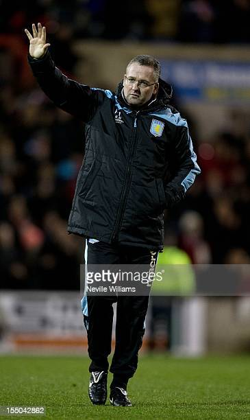 Paul Lambert manager of Aston Villa waves during the Capital One Cup Fourth Round match between Swindon Town and Aston Villa at the County Ground on...